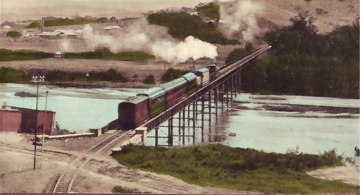 A train and steam locomotive crossing the Umgeni Bridge from North to South
